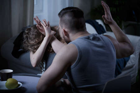 domestic: Violence at home - aggressive man beating his wife Stock Photo