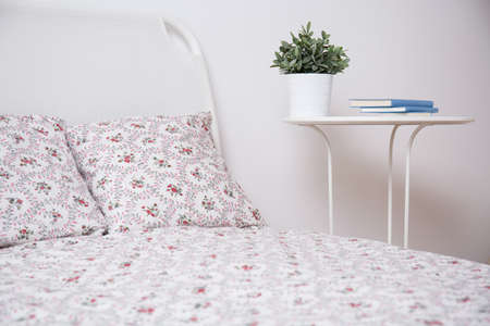 nightstand: Cozy bedroom with with bed and nightstand Stock Photo