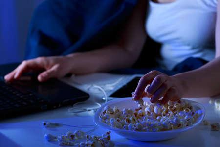greedy: Greedy girl and night snacks during movie Stock Photo