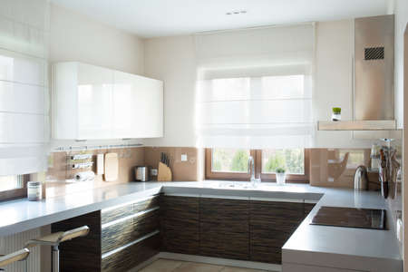 Horizontal view of beige kitchen interior design Stock Photo