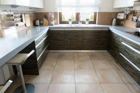 Close-up of cozy beige kitchen in modern design