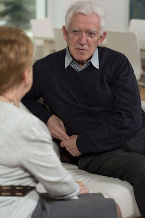 adulthood: Elder people sitting and having a conversation Stock Photo