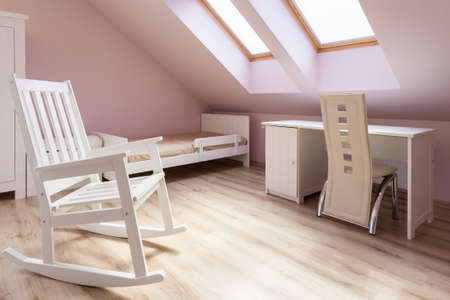 skylights: White rocking chair in cozy girls room