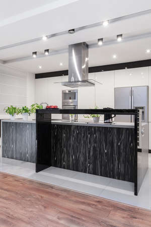 extractor: Steel extractor hood in modern stylish kitchen