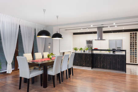 dining set: Modern kitchen and dining room in exclusive house Stock Photo