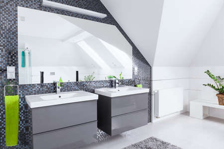 Modern white and grey bathroom in the attic