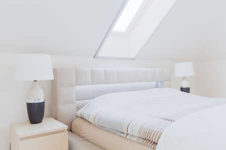 Cosy bright and luxurious bedroom in the attic