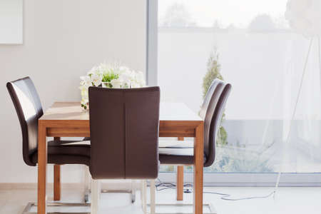 modern dining room: Modern furnished dining room with wooden table and leather chairs Stock Photo