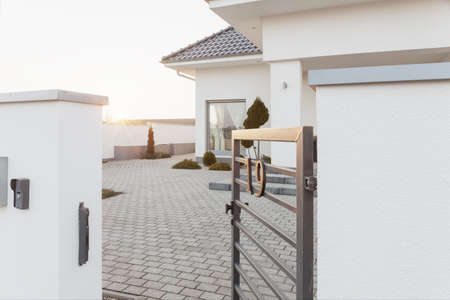 driveways: Outside view of the mansion area with steal gateway Stock Photo