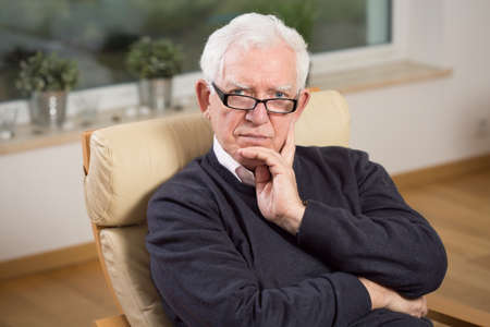 Image of retired man sitting on the chair