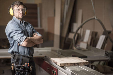 protective: Image of mature carpenter in the workshop