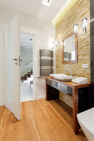 bathroom mirror: Brown exclusive bathroom in modern detached house