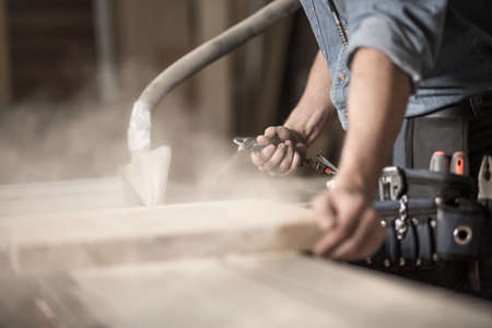 Close-up of carpenters hands working with wood Stock Photo