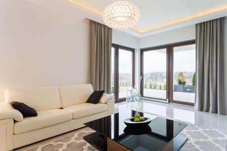 Cream sofa in bright living room interior Banco de Imagens