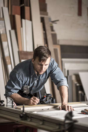carpentry: Image of young woodworker working in carpentry