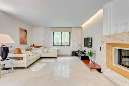 luxury living room: Cream corner sofa in spacious drawing room