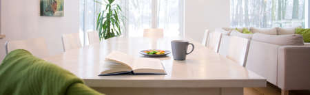 design interior: Open book on the table in living room