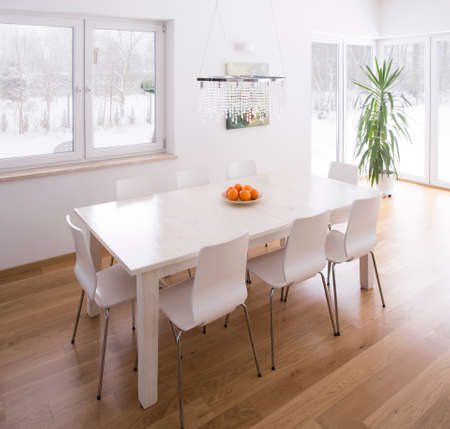 dining table and chairs: Dining table set in bright modern interior