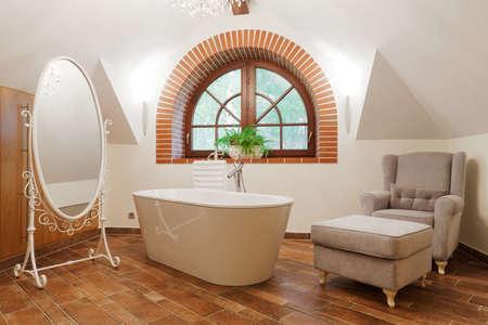 bath tub: White freestanding bath in designed exclusive restroom Stock Photo