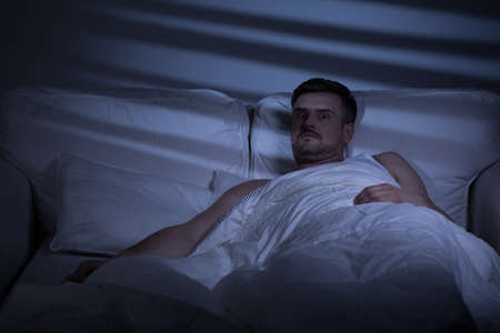 alone sad: Terrified man in bed woke up because of nightmare