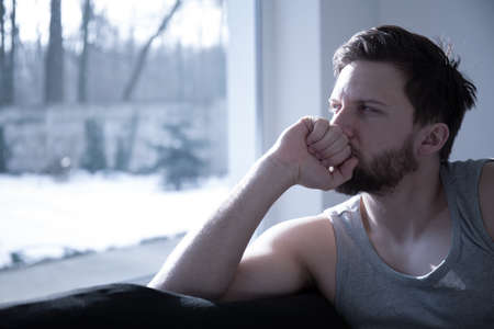 upset man: Sleeping disorders as a reason for insomnia Stock Photo