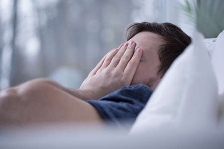 Man having some sleeping disorders like insomnia Stock Photo