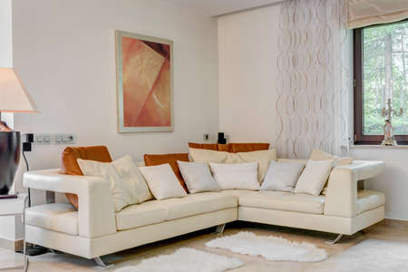 luxury living room: Cream corner sofa in luxury living room