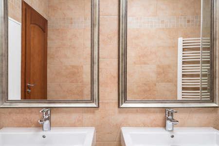 washbasins: Two washbasins and mirrors in beige toilet