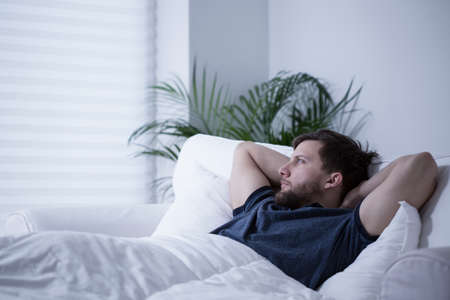 sleepless: Man suffering from insomnia after sleepless night Stock Photo