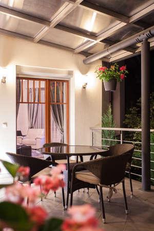 balcony: Round table on romantic balcony - view at night