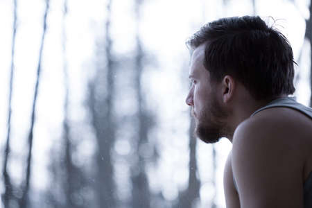 depression man: Man observing the view outside the window Stock Photo