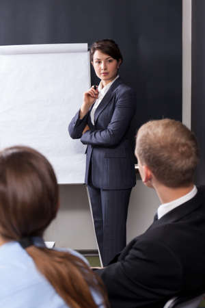lecturing: Young pretty woman lecturing during the business meeting Stock Photo