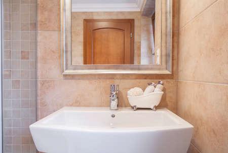 handbasin: Close-up of ceramic washbasin in beige toilet