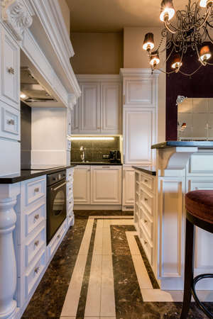 luxury apartment: Baroque luxury kitchen in huge apartment Stock Photo