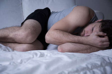 insomniac: Man trying to beat insomnia and other sleep disorders Stock Photo