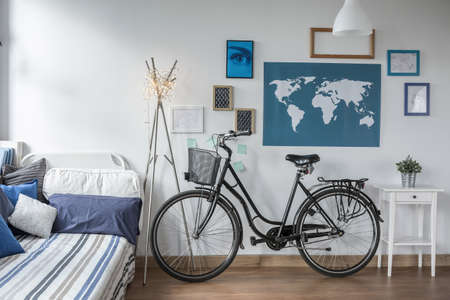 Photo of retro bicycle in teen bedroom