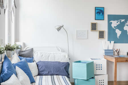 interior room: White and blue designed teen boy bedroom