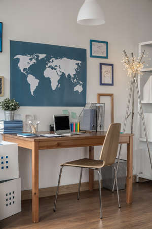 worldmap: Wooden desk and chair in study room Stock Photo
