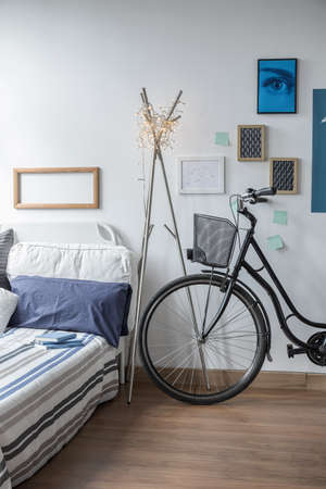 wall decoration: Vertical view of bicycle in modern bedroom Stock Photo