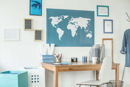 stylish boy: Designed workspace with world map in teen room