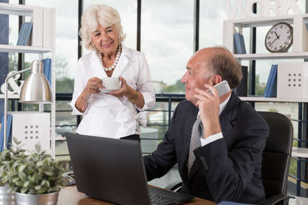 pleased: Photo of pleased aged pair during work at corporation Stock Photo