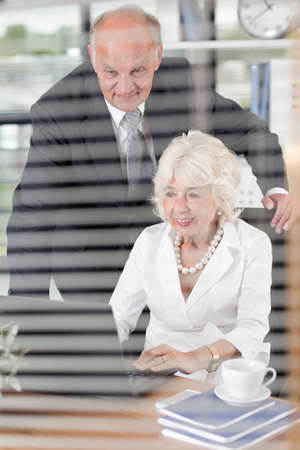 pleased: Image of pleased mature corporate workers in office Stock Photo