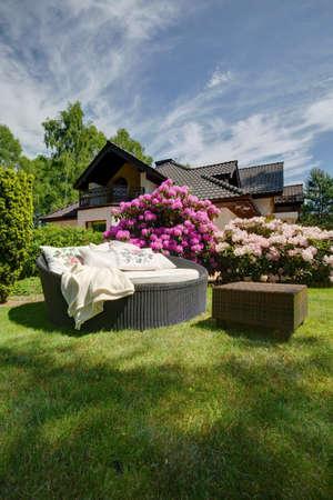 garden flower: Cozy space for relax in the garden Stock Photo