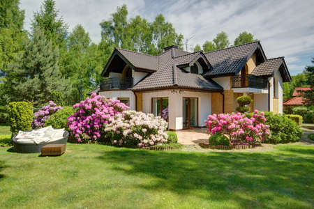 summer house: Picture of beautiful village house with garden Stock Photo