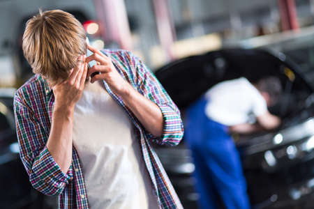 despaired: Young despaired client waiting for car repair