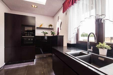 cupboards: Dark brown cupboards in modern luxury kitchen