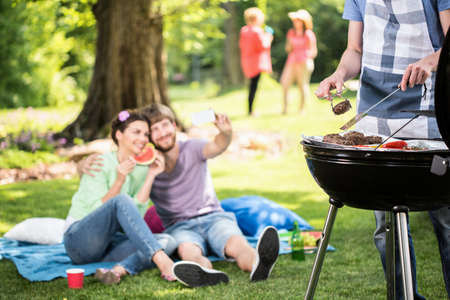 Happy people doing grill in the park