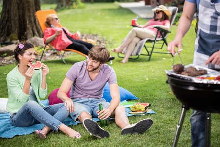 Happy smiling couple spending pleasant time outdoors Stock Photo