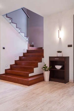 wooden stairs: Interior of bright anteroom with wooden stairway Stock Photo
