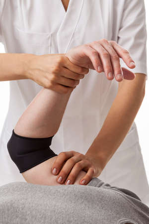 traumatic: Orthopedist examining patient after traumatic elbow injury Stock Photo